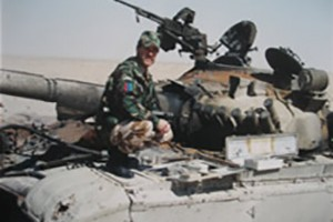 Inspecting knocked-out Iraqi tank during the first Gulf War