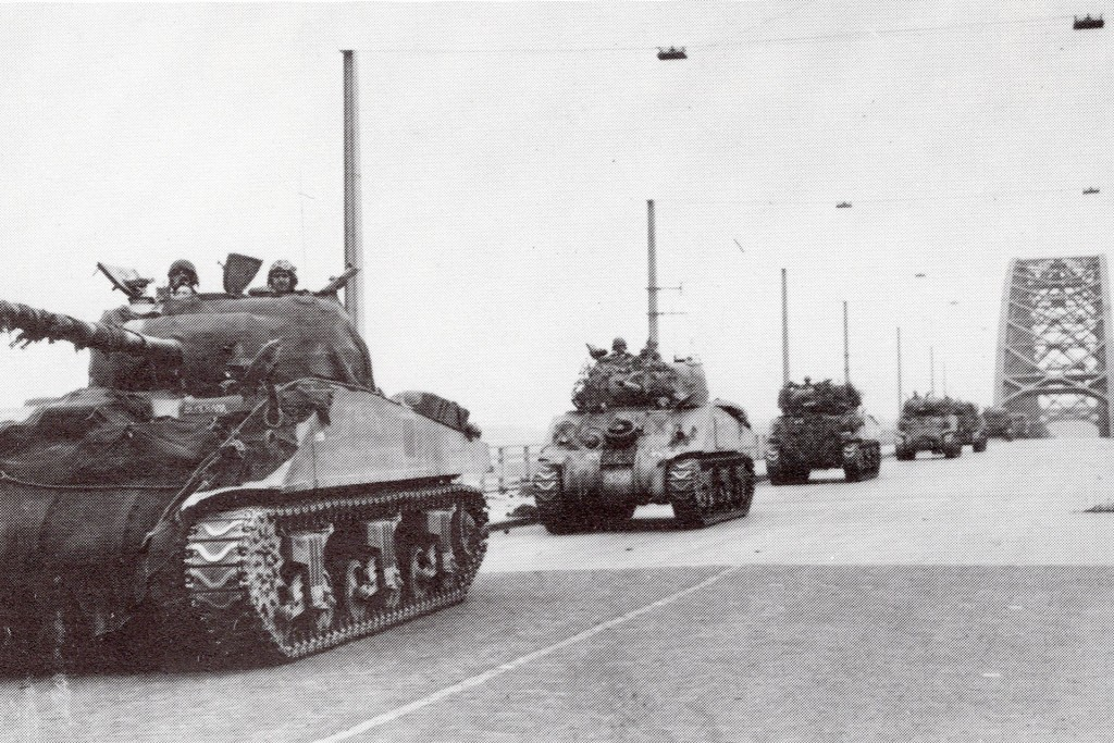 Sherman tanks crossing below, in September 1944.