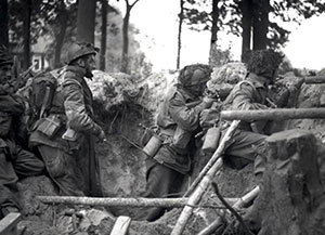 Above, paratroopers man the Airborne perimeter near the Hartenstein Hotel.
