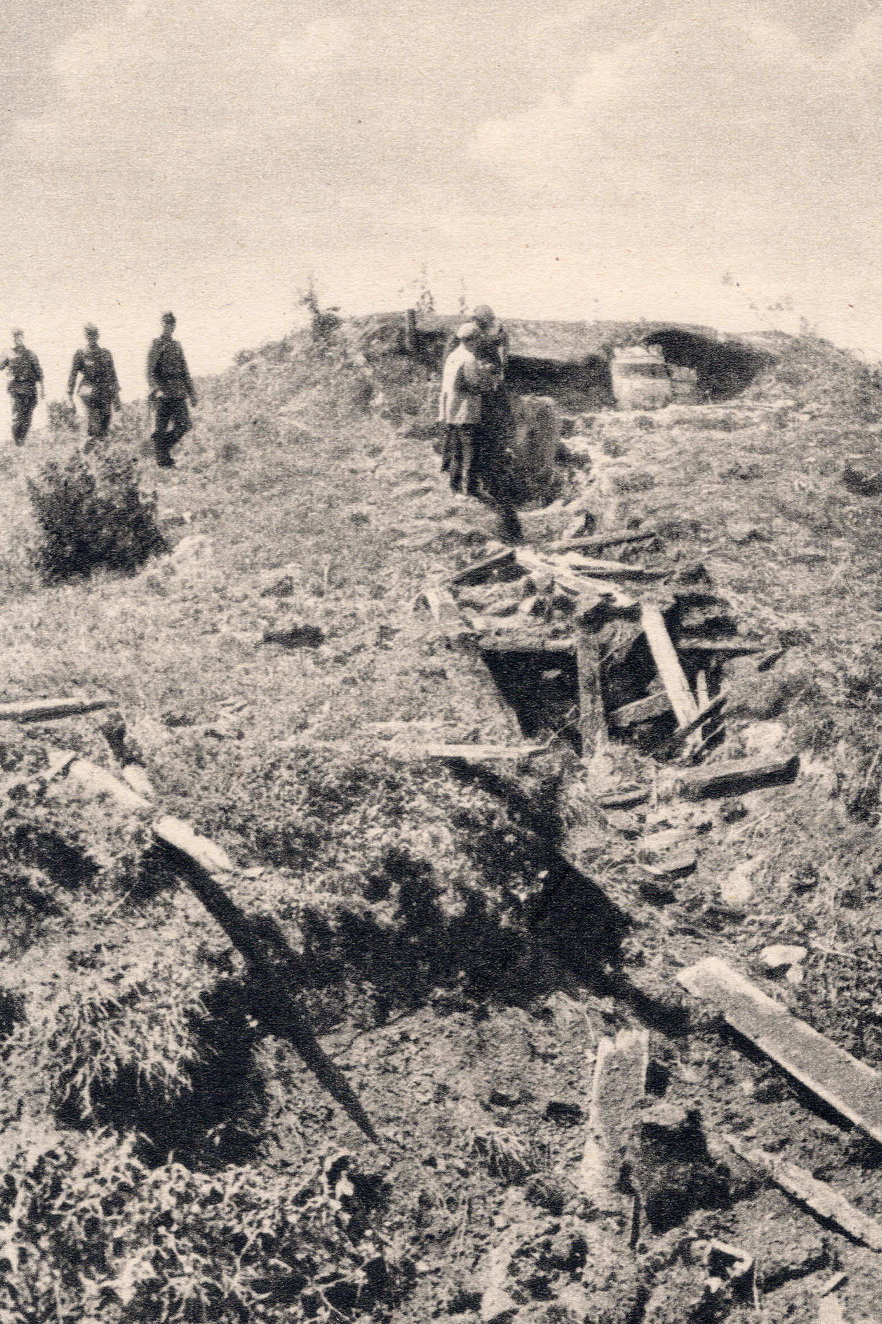 German soldiers investigate a destroyed Soviet bunker on the Stalin line in 1941.