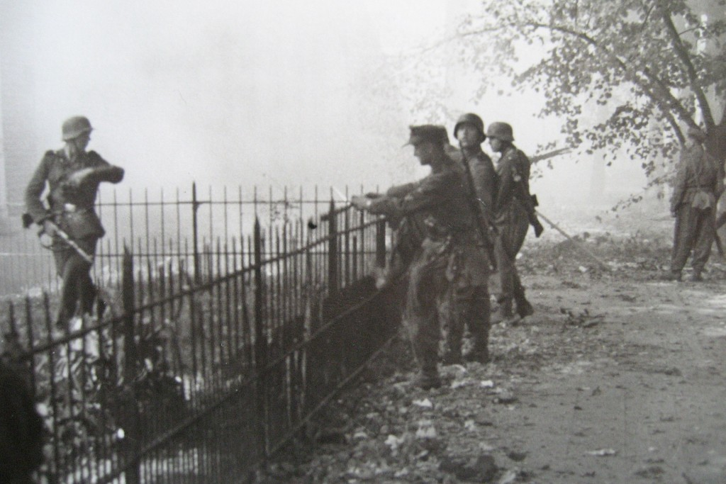 SS soldiers scale the same railings in September 1944