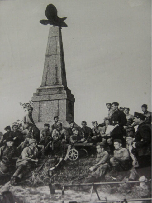 Soviet soldiers gather beneath one of the Napoleonic monuments.